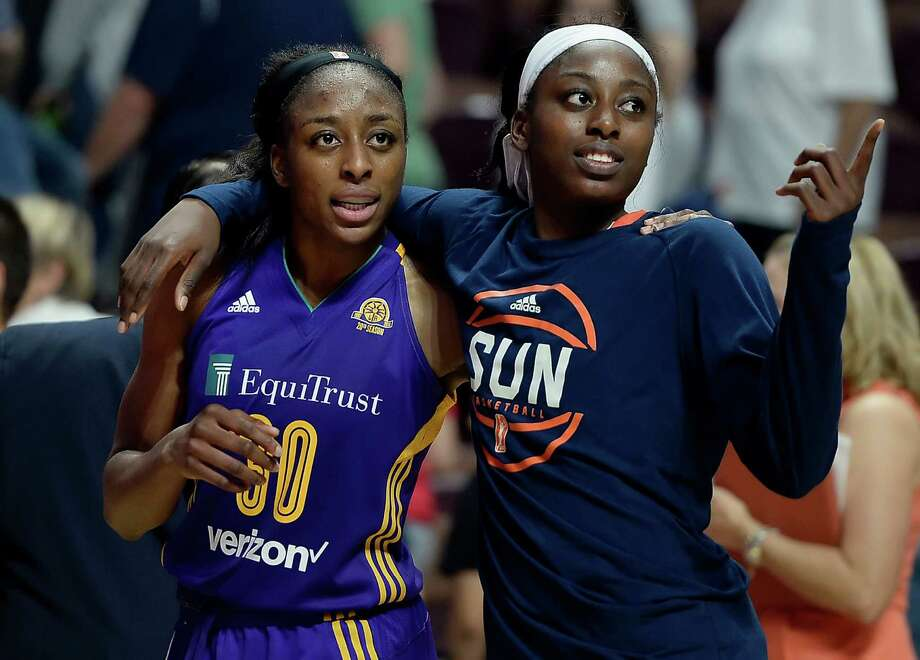 Chiney Ogwumike, right, and sister Nneka at the end of WNBA game two years ago. Photo: Jessica Hill, Associated Press / AP2016