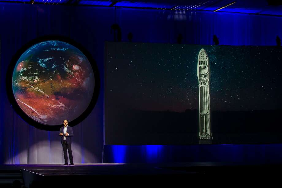 Tesla Motors CEO Elon Musk speaks about the Interplanetary Transport System he plans to launch for a flight to Mars. Photo: HECTOR-GUERRERO, AFP/Getty Images