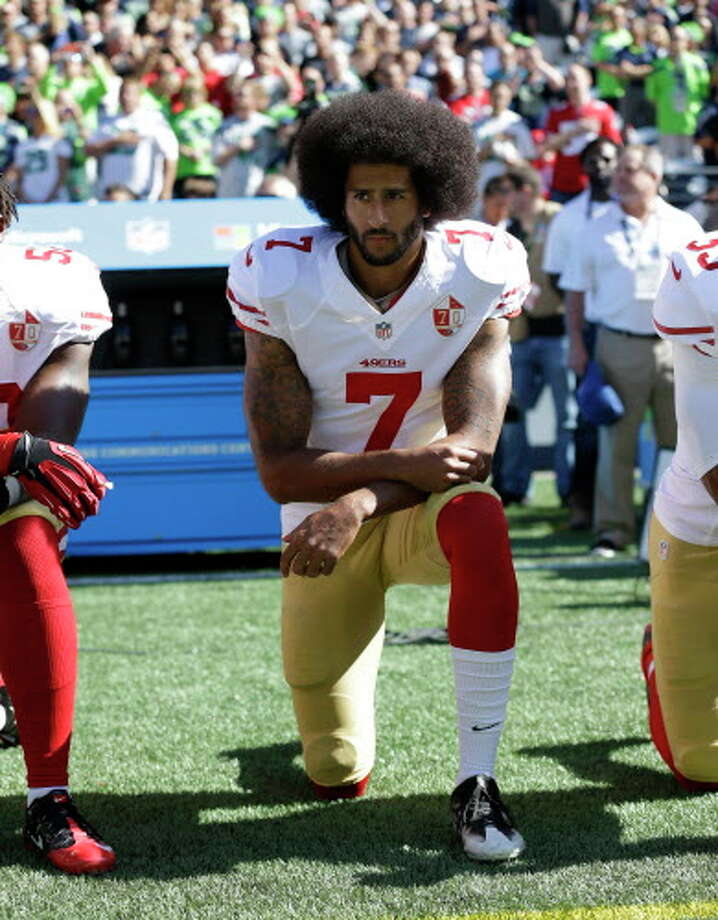 San Francisco 49ers' Colin Kaepernick kneels during the national anthem before an NFL football game against the Seattle Seahawks, Sunday, Sept. 25, 2016, in Seattle. (AP Photo/Ted S. Warren) Photo: Ted S. Warren, Associated Press