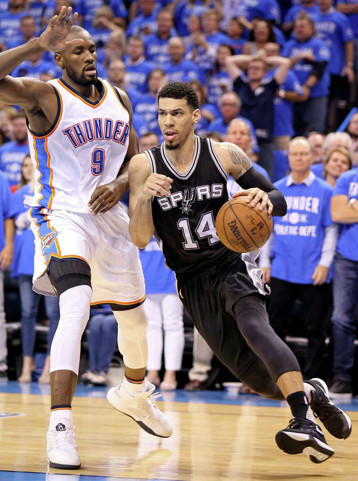 Spurs' Danny Green looks for room around the Thunder's Serge Ibaka during second-half action of Game 6 in the Western Conference semifinals on May 12, 2016 at Chesapeake Energy Arena in Oklahoma City.