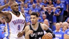 Spurs' Danny Green looks for room around the Thunder's Serge Ibaka during second half action of Game 6 in the Western Conference semifinals on May 12, 2016 at Chesapeake Energy Arena in Oklahoma City.
