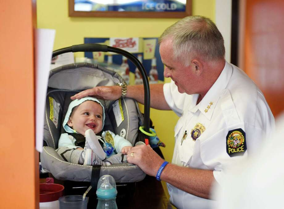 Greenwich Chief of Police James Heavey says hello to 7-month-old Michael Zeh, of Glenville, during the Thank-a-Cop event at Joey B's Famous Chili Hub in the Cos Cob section of Greenwich, Conn. Tuesday, Sept. 27, 2016. Greenwich police officers hung out at Joey B's Tuesday to chat with local civilians in a casual setting about police-related and non-police-related matters alike. Photo: Tyler Sizemore / Hearst Connecticut Media / Greenwich Time