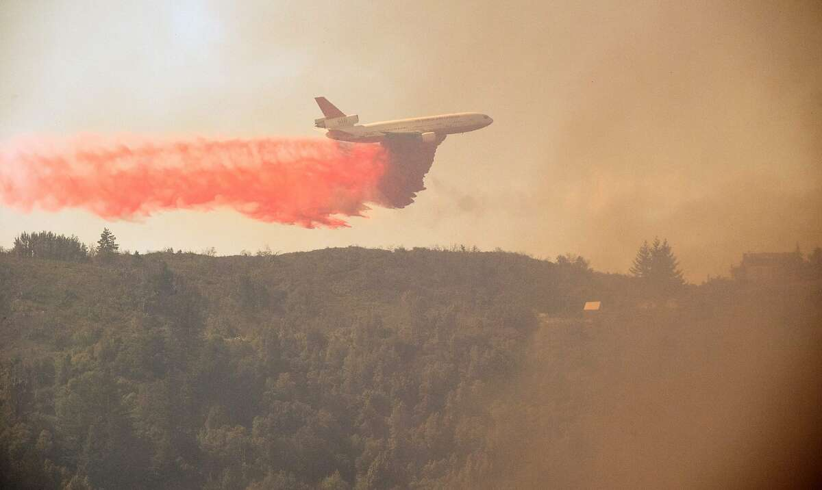 An air tanker drops retardant on a ridge in the Santa Cruz Mountains near Loma Prieta, California on September 27, 2016. The Loma Fire has charred more than 1500 acres and burned multiple structures in the area.