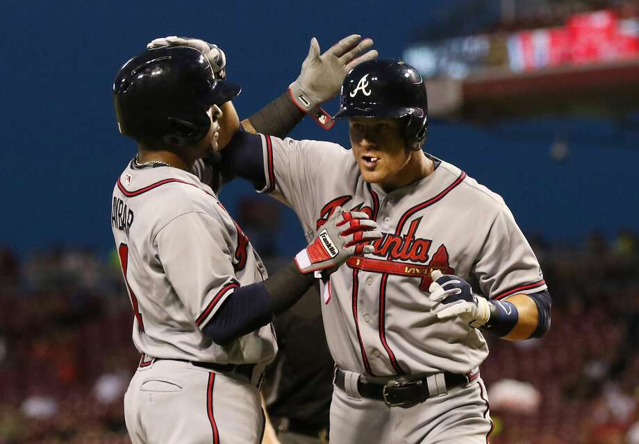 Gordon Beckham, right, is greeted at the plate after hitting one of his five homers this season. Photo: Gary Landers, Associated Press