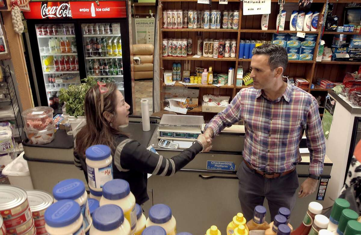 San Francisco candidate for Supervisor District 11 Ahsha Safai,(right) greets Thelma Orozco owner of Anna's Market along Broad Street in San Francisco, California on Tues. Sept. 27, 2016.