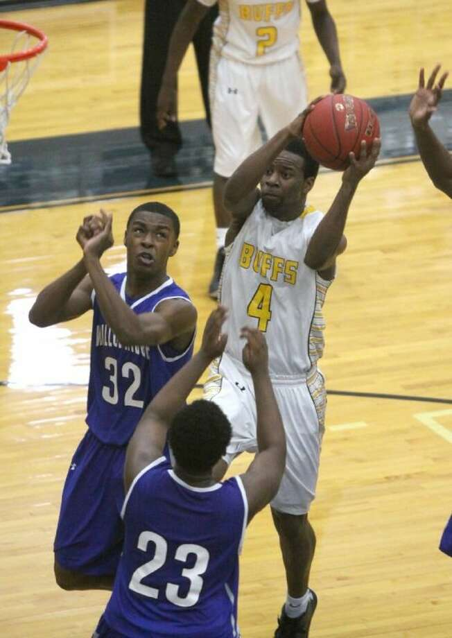 Marshall's Damien Day drives in against Willowridge's Justin Sanders and Jamal Emmers during their District 22-4A in 2013 at Hopson Fieldhouse. Day is one of 50 finalists for the Guy V. Lewis Award. Visit hcnpics.com for more photos. Photo: Alan Warren