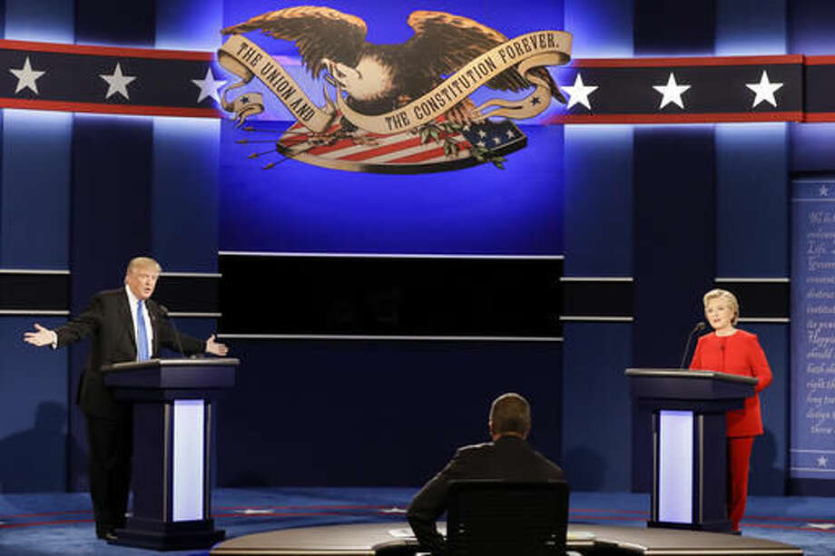 Republican presidential nominee Donald Trump answers a question as Democratic presidential nominee Hillary Clinton listens during the presidential debate at Hofstra University in Hempstead, N.Y., on Monday