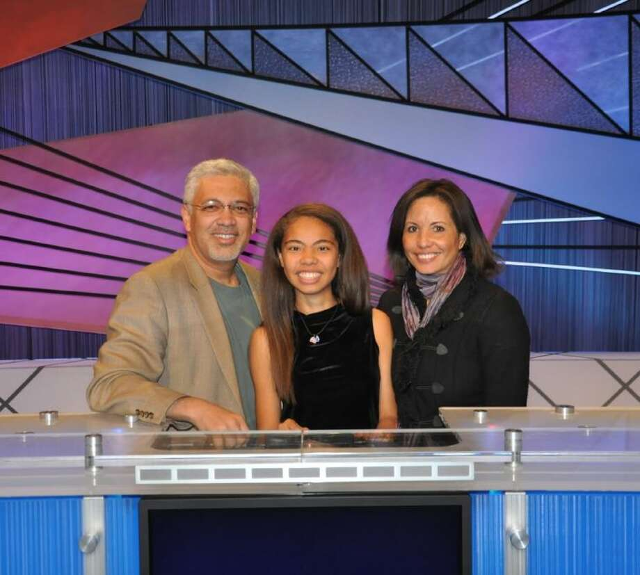 Irene Vazquez, center, on the set of JEOPARDY! with parents Jose and Sheryl Vazquez of West University Place. The 14-year-old, an eighth-grader at St. John's School, is a contestant in the upcoming JEOPARDY! Teen Tournament, which starts Jan. 30. Photo: Submitted Photo