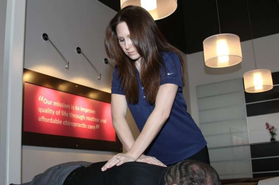 Dr. Jamie Anderson demonstrates some of her techniques she uses to treat patients at The Joint.