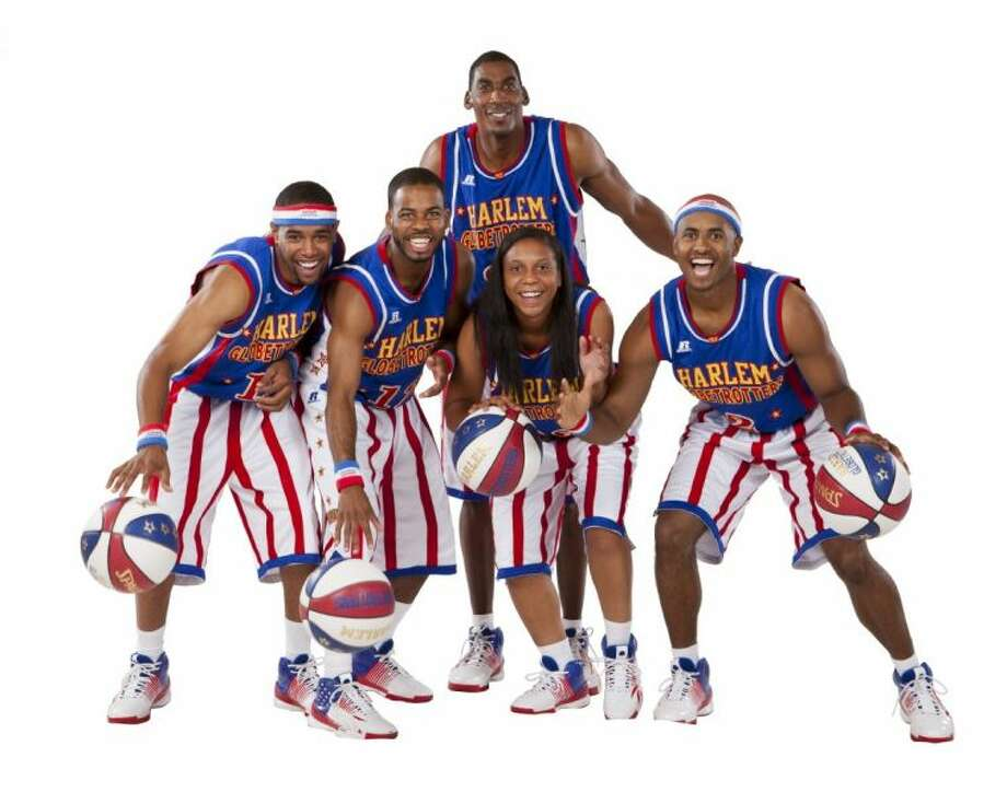 Mighty Mitchell is the newest female member of the Harlem Globetrotters. Pictured are Hi-Lite Bruton, Cheese Chisholm, Ant Atkinson, Mighty Mitchell and Dizzy Grant. Photo: Submitted Photo