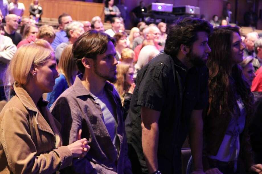 Approximately 300 people attended the grand opening service of Woodlands Church's new Conroe campus at Conroe High School Sunday.
