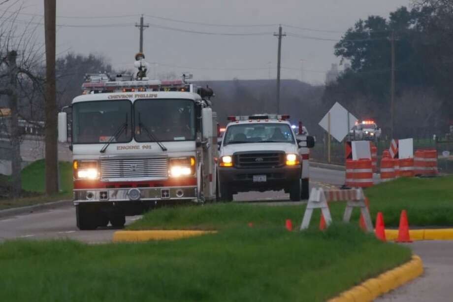 A Chevron Phillips emergency response vehicle emerges from a location on Genoa Red Bluff during a hazardous materials incident Tuesday, Jan. 15. / © 2012 Kirk Sides/Houston Community Newspapers