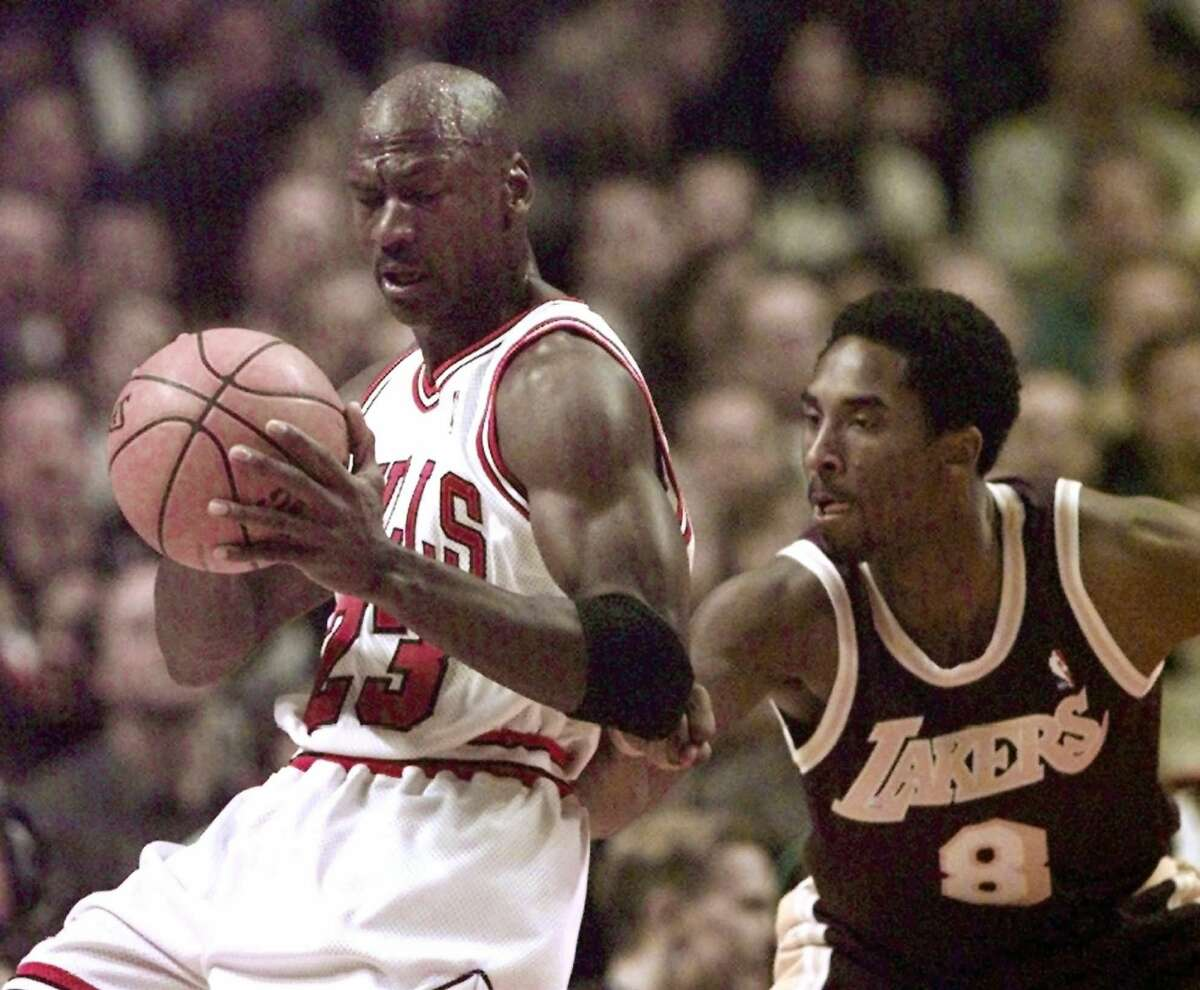 Chicago Bulls' Michael Jordan (23) tries to get around Los Angeles Lakers' Kobe Bryant (8) during the first quarter at the United Center in Chicago, Wednesday, Dec. 17, 1997. (AP Photo/Fred Jewell) ALSO RAN 2/7/98