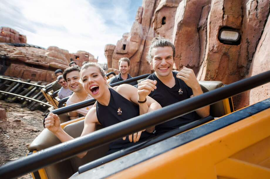 LAKE BUENA VISTA, FL - MARCH 12: In this handout photo provided by Disney Parks, Front Row, L-R, Kimberly Perry, Reid Perry, Second Row, Neil Perry of The Band Perry take a ride on Big Thunder Mountain Railroad at Magic Kingdom Park March 12, 2016 in Lake Buena Vista, Florida. The band visited Walt Disney World Resort during a break from their tour.