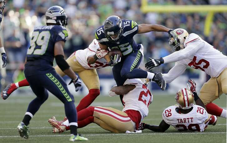 Seattle Seahawks' Jermaine Kearse (15) carries against the San Francisco 49ers in the second half of an NFL football game, Sunday, Sept. 25, 2016, in Seattle. (AP Photo/John Froschauer)