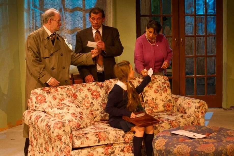 """Pondering over the murder of malicious Oliver in Agatha Christie's """"Spider Web"""" at Clear Creek Community Theatre, are friends Hugo Birch (Bob Peeples), Sir Rowland Delahaye (John Lazo), Clarissa Hailsham (C. Alane Johnson) and step-daughter Pippa (Sonja Kozuch). The fascinating play runs weekends through Sunday, January 27. Call 281-335-5228 for information and reservations soon."""