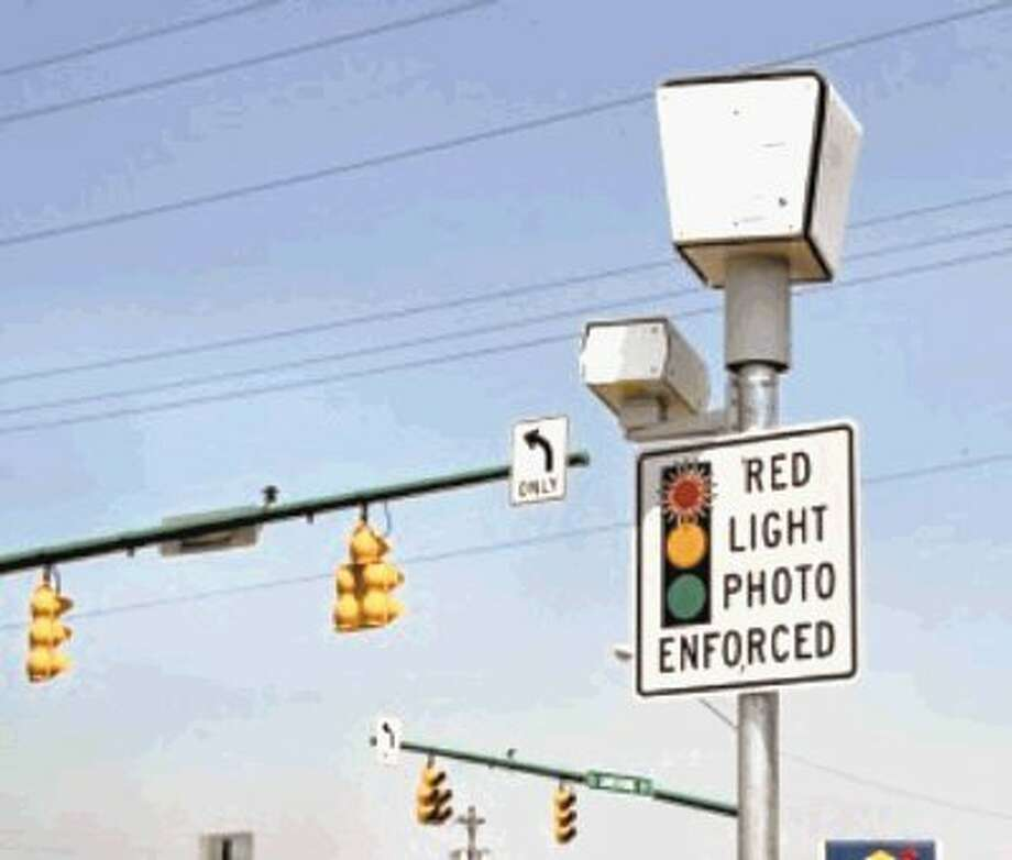 No more: Houston could end redlight camera battle by paying a nearly $5 million settlement. / @WireImgId=2513303