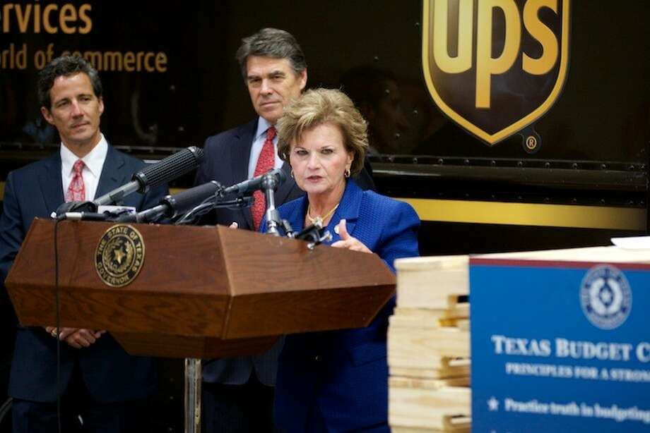 Rep. Linda Harper-Brown and Gov. Rick Perry announce they would continue to push for an end to diversions from the state highway fund, as part of Perry's Texas Budget Compact.