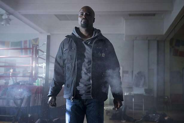 "Mike Colter stars in ""Luke Cage,"" coming Sept. 30, 2016 on Netflix. (Myles Aronowitz/Netflix)"