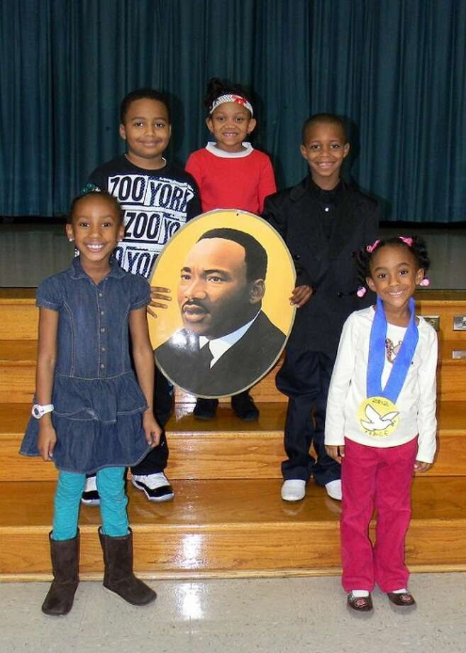 Students at Glover Elementary School celebrated Dr. Martin Luther King Day with a schoolwide parade on Jan. 13 that featured students from all grade levels. Students marched along the hallways carrying posters, banners and artwork honoring the civil rights activist. Following the parade, students and guests gathered in the auditorium for a program that included poetry and essay readings, facts about Dr. King, and a dance tribute and skit. Felicia Johnson, counselor, coordinated the event. Pictured clockwise, from the top are: Daizha Moton, Keshawn Miner, Kynnedi Phillips, Paris Jackson, and Brandon Watson.