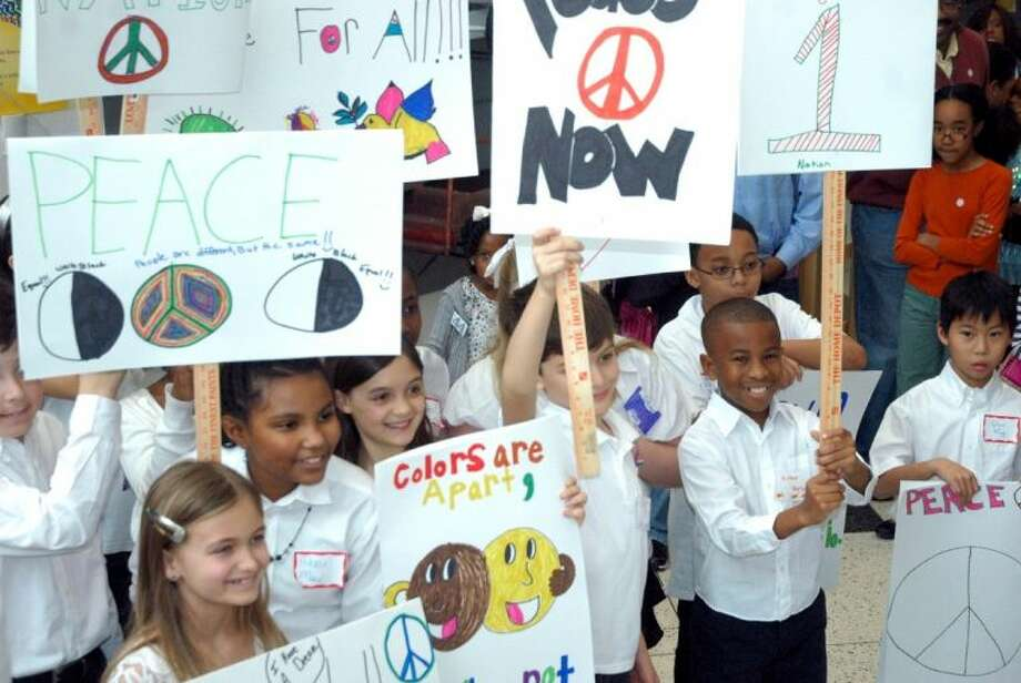 Children participate in a peace rally during a Martin Luther King, Jr. Day celebration Monday at the Children's Museum of Houston. Participants heard oratory, and saw Dr. Thomas F. Freeman of Texas Southern University presented the 2013 Caryakid Award. Freeman taught King at Morehouse College in the mid-1940s.