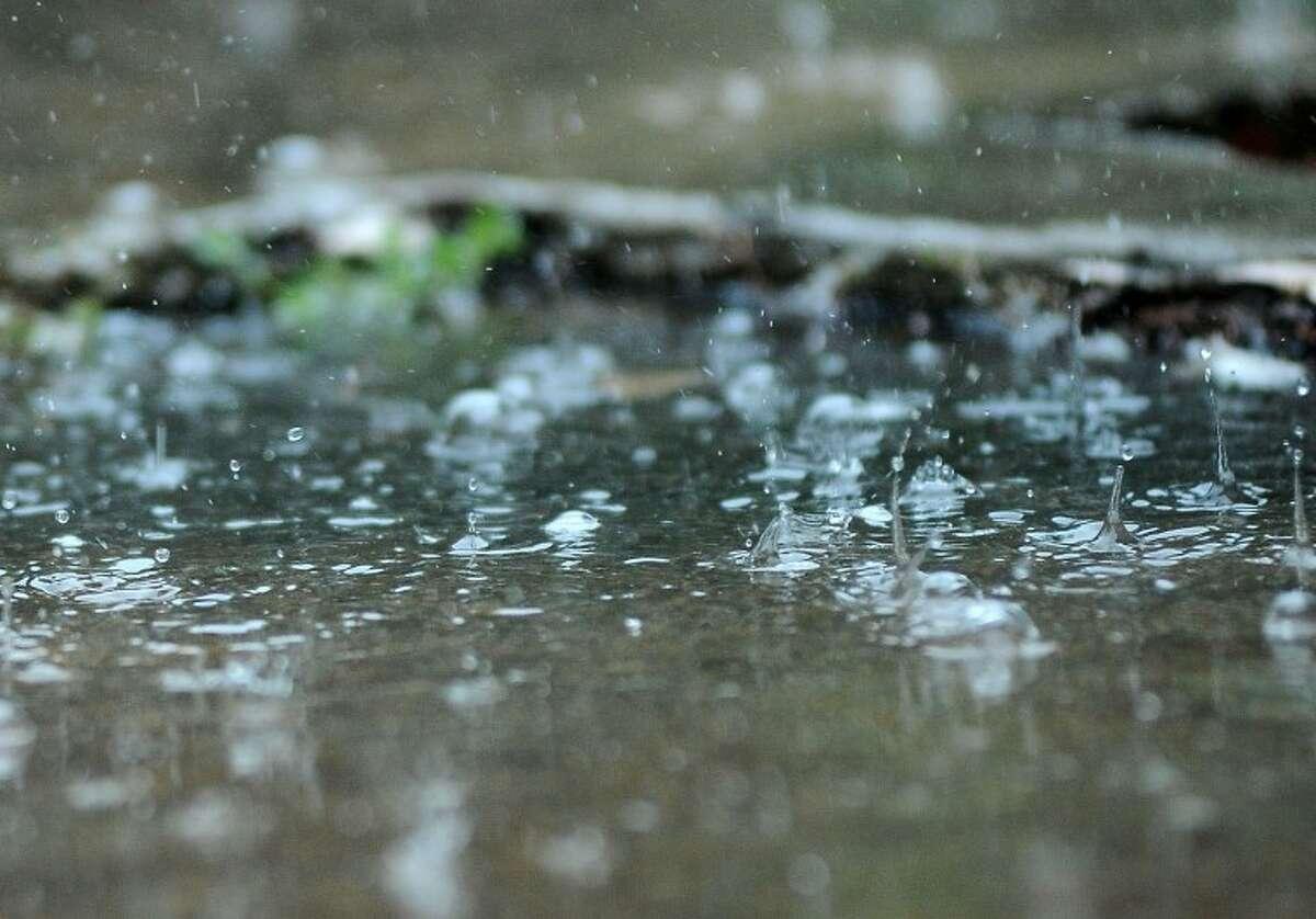 Rain drops splash as they fall into puddles during a rain shower Wednesday 6\u002f22\u002e