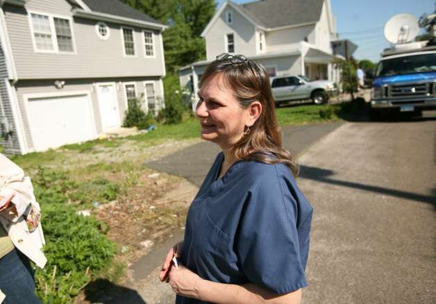 Debbie Bussolari, a resident of Long Hill Avenue in Shelton, talks to the media on Tuesday, May 4, 2010, outside, 119 Long Hill Avenue, the former home of Faisal Shahzad. Shahzad, a suspect in the attempted bombing in Times Square Saturday night was taken into custody late Monday by FBI agents and New York Police Department detectives while trying to leave the country. Photo: Brian A. Pounds / Connecticut Post