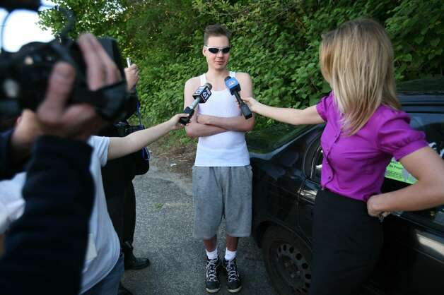 Adam Abbels, a resident of Long Hill Avenue in Shelton, talks to the media on Tuesday, May 4, 2010,in the area of 119 Long Hill Avenue, the former home of Faisal Shahzad. Shahzad, a suspect in the attempted bombing in Times Square Saturday night was taken into custody late Monday by FBI agents and New York Police Department detectives while trying to leave the country. Photo: Brian A. Pounds / Connecticut Post