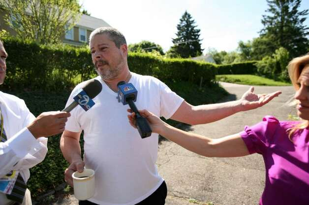Scott Berg, a resident of Long Hill Avenue in Shelton, talks to the media on Tuesday, May 4, 2010,in the area of 119 Long Hill Avenue, the former home of Faisal Shahzad. Shahzad, a suspect in the attempted bombing in Times Square Saturday night was taken into custody late Monday by FBI agents and New York Police Department detectives while trying to leave the country. Photo: Brian A. Pounds / Connecticut Post