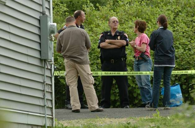 Investigators on the scene at 119 Long Hill Avenue in Shelton, Conn., the former home of Faisal Shahzad.  on Tuesday May 04, 2010. Shahzad, a suspect in the attempted bombing in Times Square Saturday night was taken into custody late Monday by FBI agents and New York Police Department detectives while trying to leave the country. Photo: Christian Abraham / Connecticut Post