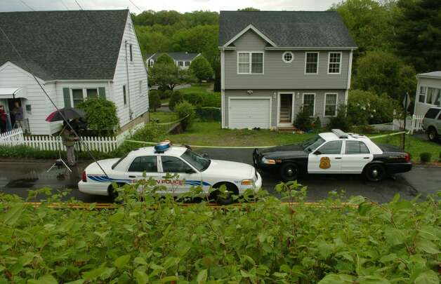 Police vehicles stationed in front of 119 Long Hill Avenue in Shelton, Conn., the former home of Faisal Shahzad on Tuesday May 04, 2010. Shahzad, a suspect in the attempted bombing in Times Square Saturday night was taken into custody late Monday by FBI agents and New York Police Department detectives while trying to leave the country. Photo: Christian Abraham / Connecticut Post
