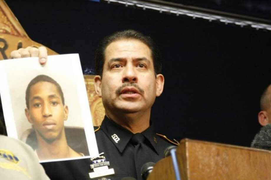 Harris County Sheriff Adrian Garcia displays a picture of Carlton Berry, who was charged by HCSO for two counts of felony aggravated assault following the shooting incident at Lone Star College-North Harris Tuesday.