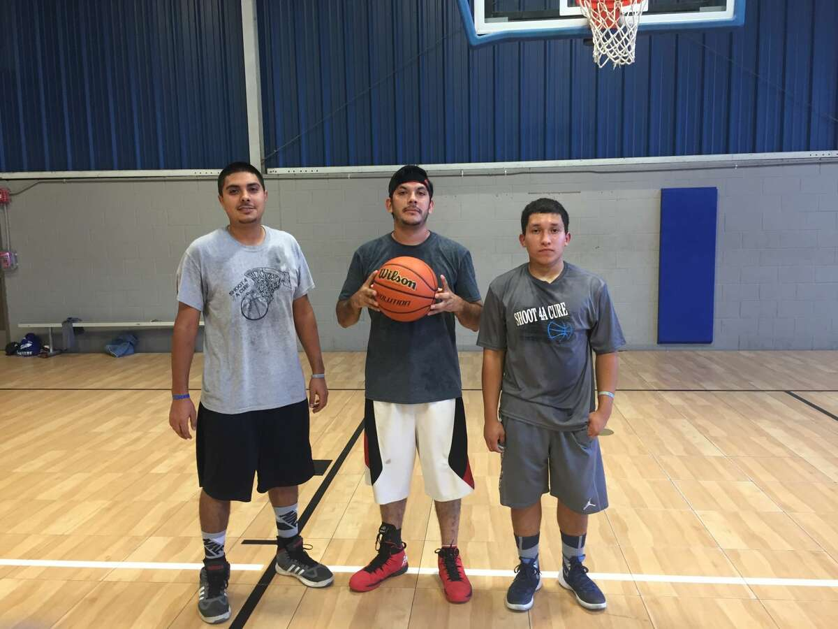 In advance of the American Diabetes Association's Step Out Walk, which is Oct. 8, in Odessa, the walk team supporting Thomas Zarate, far right, held a fundraising basketball tournament. With Zarate are Joel Patnino, left, and Caleb Patino.