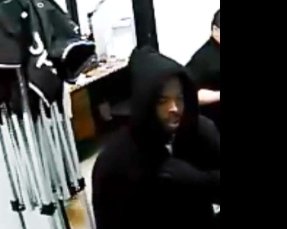 A surveillance camera captured footage of the suspects as the robbed a cell phone store at gun point.