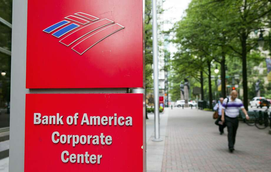 Pedestrians walk past Bank of America Corp. headquarters in Charlotte, N.C. An ordinance the Board of Supervisors passed Tuesday would prevent a renewal of its contract to provide payroll services to the city. Photo: Chris Keane, Bloomberg