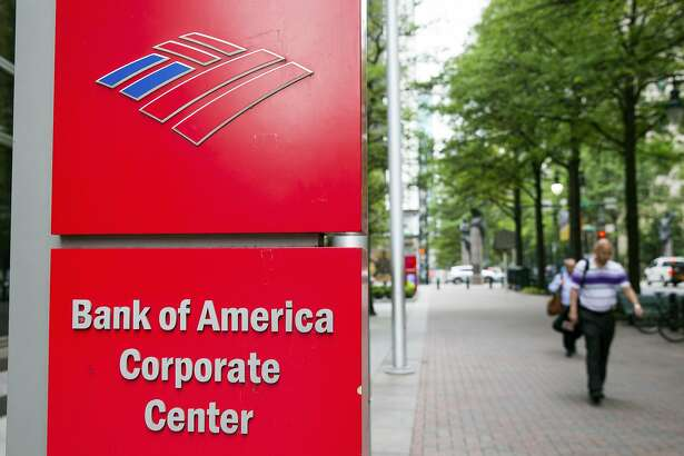 Pedestrians walk past Bank of America Corp. headquarters in Charlotte, North Carolina, U.S., on Monday, May 2, 2016. Bank of America's revenue may decline 1 percent in 2016, similar to 2015, before growing 6-7 percent in 2016-17, based on a consensus of analysts in a Bloomberg Industries report published in April. Photographer: Chris Keane/Bloomberg