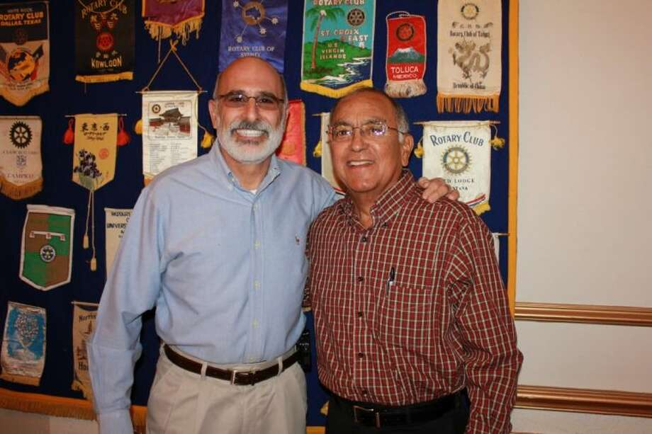 The Mane Event program will feature a roast of Jim Ferris, president and CEO of Wismer Distributing Company (left), pictured with Bay Area Homeless Services board member Pete Alfaro.
