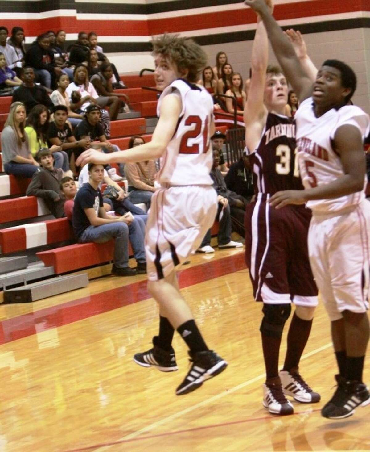 Nick Willis shoots over two Cleveland defenders for the game-winning shot in Tarkington's last second win over the Indians.