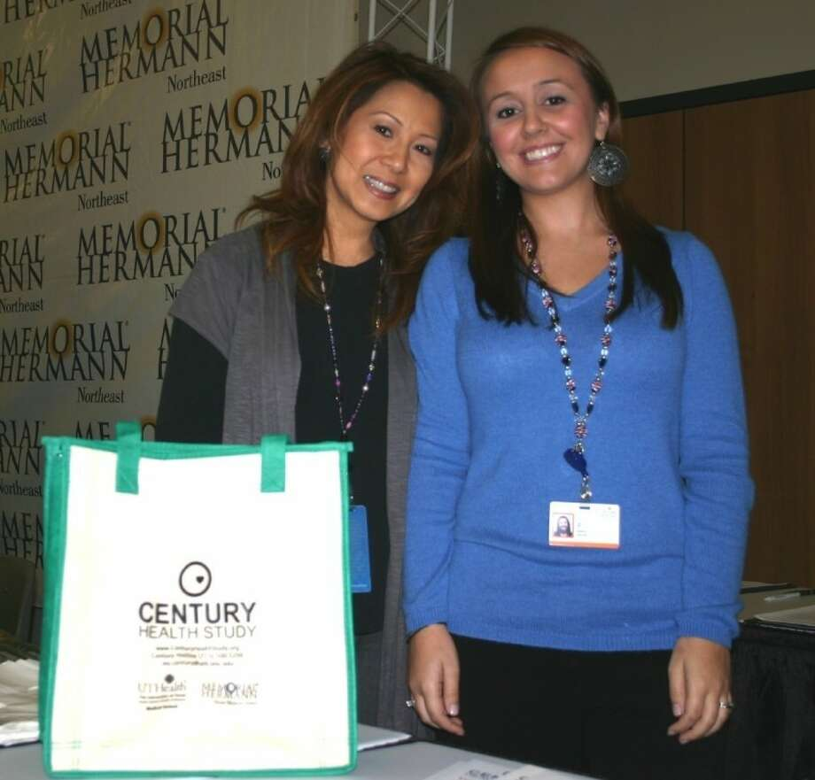 Linh H. Trinh, left, and Maida Suljic, research coordinators with the Century Health Study, are seeking a limited number of participants with certain risk factors who will receive free-of-charge advanced cardiac care in the clinical trial. The researchers were among the health care experts who served the community at the first ever Free New Year Health Fair that the Dayton Community Center hosted on Thursday, Jan. 26. For more information about the study, call 713-500-5200. Photo: STEPHEN THOMAS