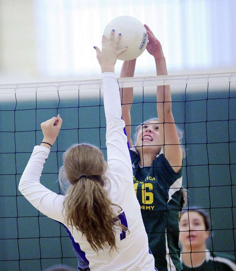At center, Madlin Decker (#16) of Greenwich Academy blocks a Masters shot during the girls high school volleyball match between Greenwich Academy and Masters School at Greenwich Academy, Conn., Tuesday, Sept. 27, 2016. Photo: Bob Luckey Jr. / Hearst Connecticut Media / Greenwich Time