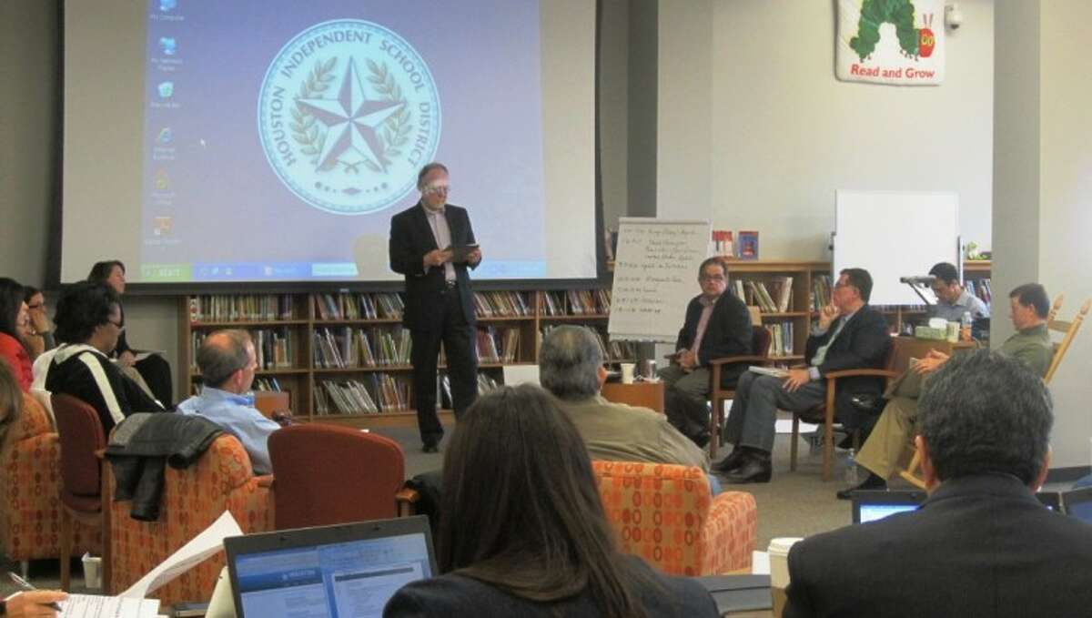 HISD counsel David Thompson updates trustees on the lawsuits challenging state funding of public education at their retreat Saturday in Bellaire.