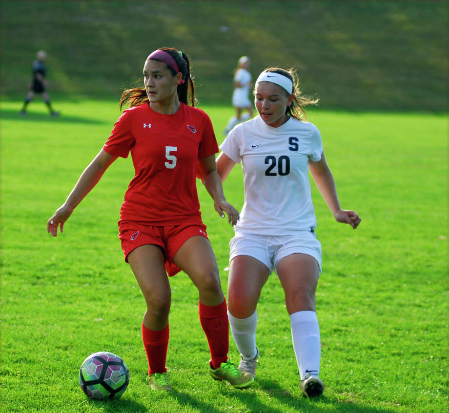 Greenwich's Kimberly Kockenmeister, left, and Staples' Annie Amacker battled for possession during a girls soccer game on Tuesday, September 27th, 2016. Photo: Ryan Lacey/Hearst Connecticut Media / Westport News Contributed