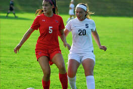 Greenwich's Kimberly Kockenmeister, left, and Staples' Annie Amacker battled for possession during a girls soccer game on Tuesday, September 27th, 2016.