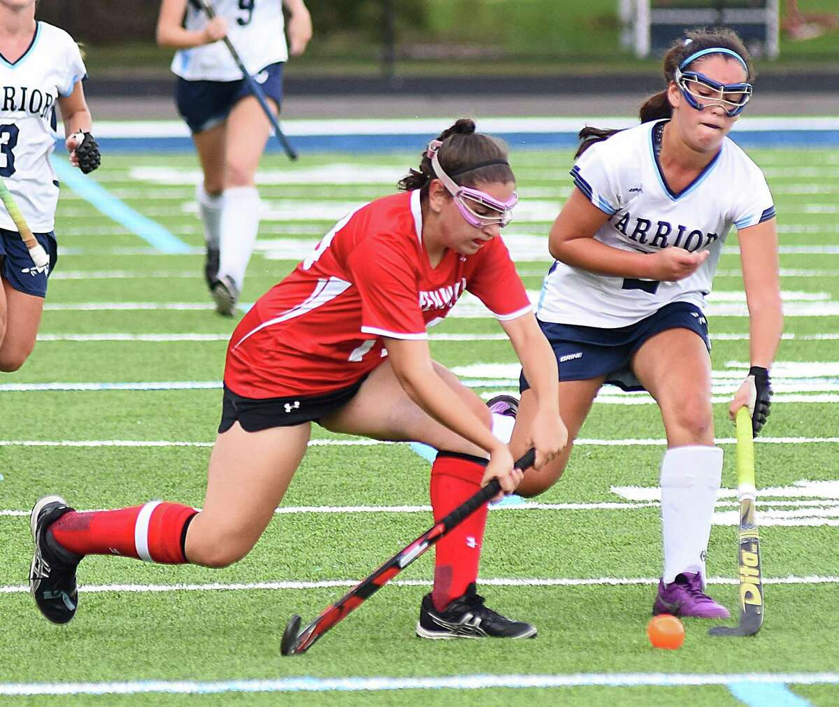 Wiltom's Emma Rothkopf, right, defends as Claudia Bonaparte of Greenwich makes a pass during Tuesday's FCIAC field hockey game at Fujitani Field in Wilton. The host Warriors defeated the Cardinals 4-1.