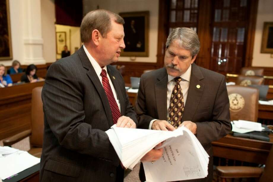 (Right) Rep. Larry Taylor (R-Friendswood) confers with Rep. John Otto (R- Dayton).