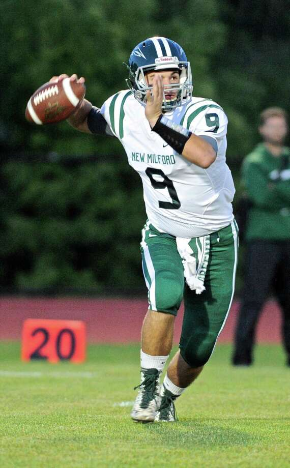 New Milford quarter back Tyler Sullivan is out of action this week due to a knee injury. Photo: H John Voorhees III / Hearst Connecticut Media / The News-Times