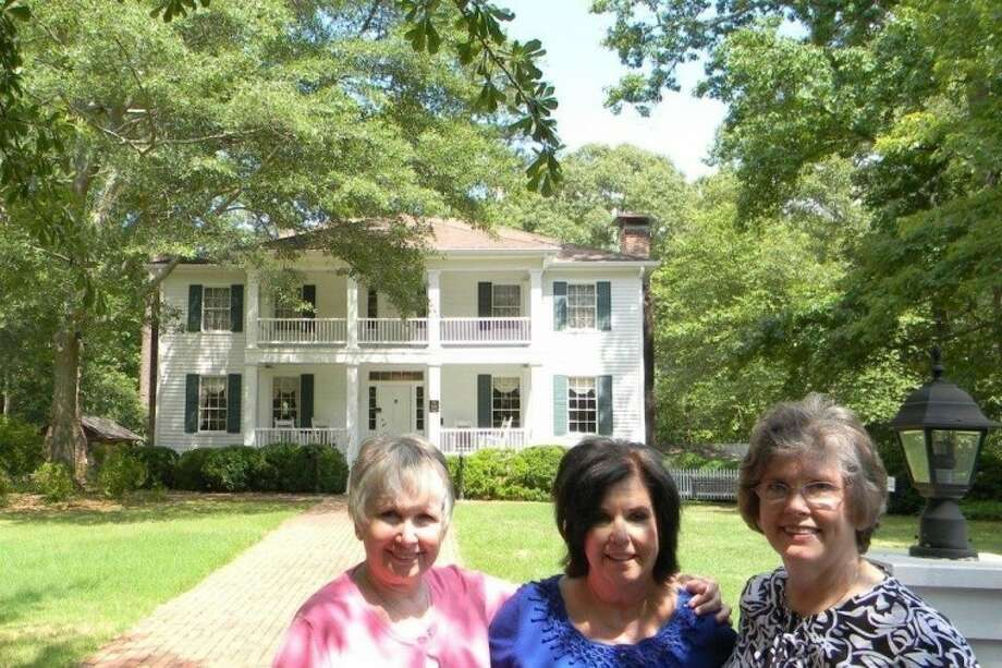 "Carol Dial, left, Sue Friday, center, and Janet Batchelor, right, are all members of the first families of Clayton County, Ga. Their great-great-grandfather Witmill Philips Allen built the Stately Oaks home in 1839. The home was the inspiration for the plantation home of Tara in Margaret Mitchell's novel ""Gone with the Wind."" Photo: Submitted Photo"