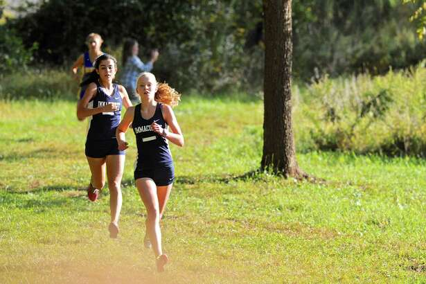 Immaculate's Angela Saidman leads team mate Danielle Marcone and Newtown's Olivia Hage during the high school cross country meet between Stratford, New Milford, Newtown and Immaculate high schools on Tuesday afternoon, September 27, 2016, at Tarrywile Park, in Danbury, Conn.