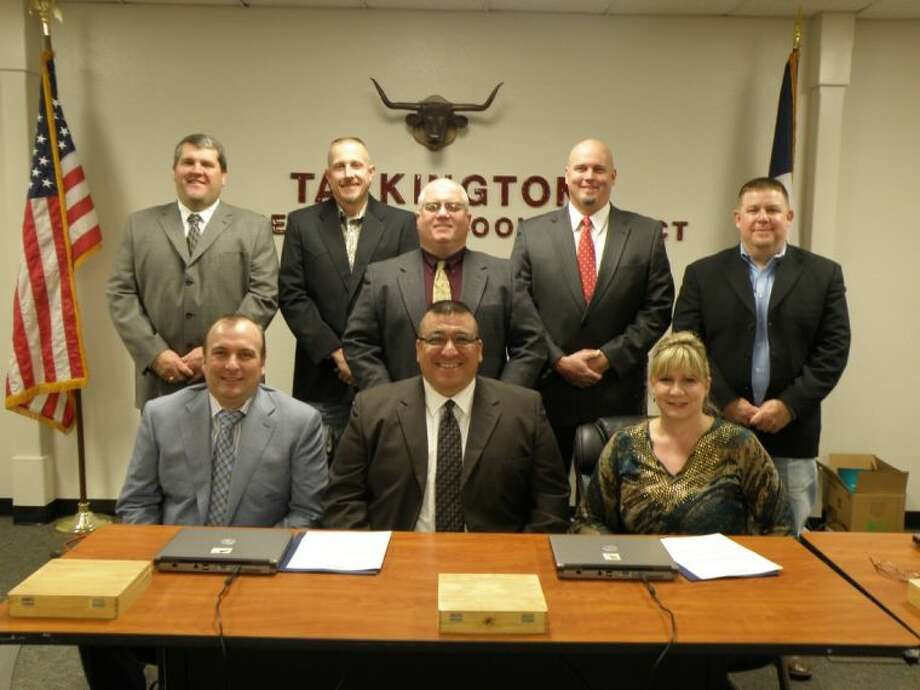 The Tarkington ISD trustees are (back row) Grant Cook, Allen Coogler, Kevin Weldon, Dwayne Stovall and Pete Vandver; (seated) Michael Johnson, president; Paul Consemiu, vice-president; and Kem Arnold, secretary. The picture was taken by Denise Johnson. Photo: DENISE JOHNSON