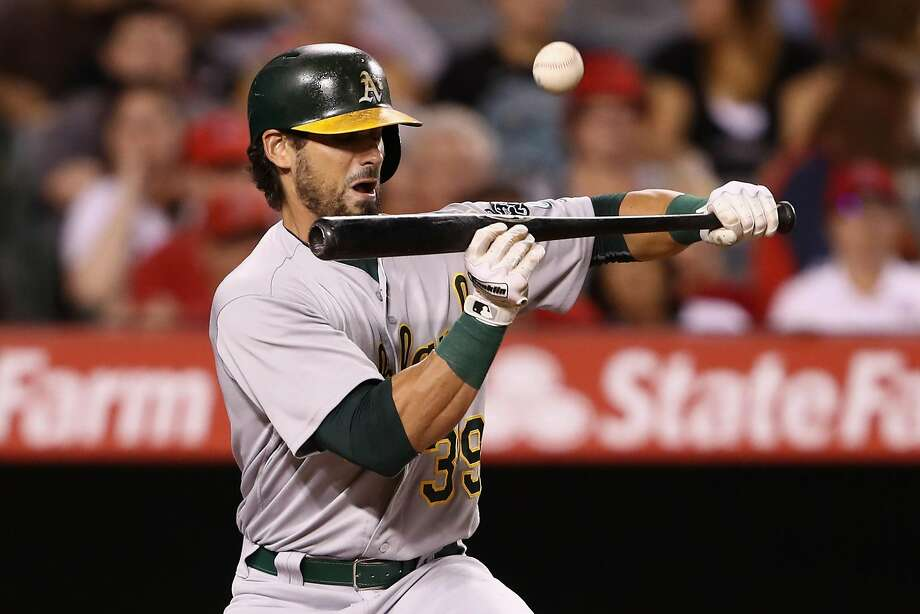 ANAHEIM, CA - SEPTEMBER 26:  Brett Eibner #39 of the Oakland Athletics flies out while bunting during the eighth inning of a game against the Los Angeles Angels of Anaheim at Angel Stadium of Anaheim on September 26, 2016 in Anaheim, California.  (Photo by Sean M. Haffey/Getty Images) Photo: Sean M. Haffey, Getty Images
